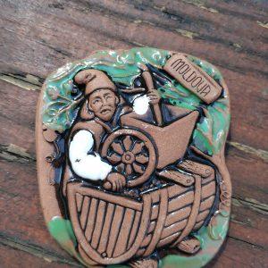 Pottery souvenir Man making wine