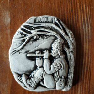 Pottery souvenir man with a whistle