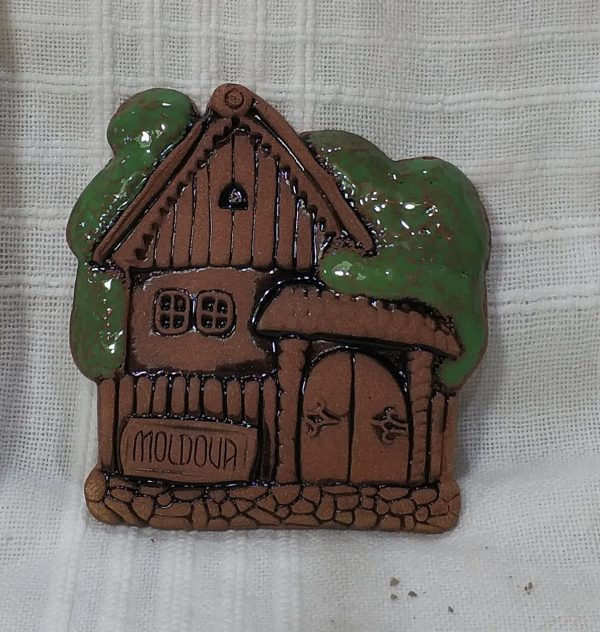 Pottery souvenir green roof house